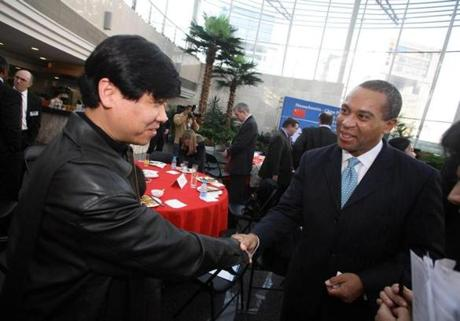 Deval Patrick shook hands with a Chinese businessman at Tsinghua University in Beijing, China, during a 2007 trip.